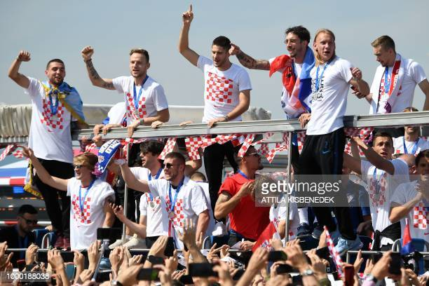 TOPSHOT Croatian national football team members ride an openroof coach in Zagreb International Airport on July 16 2018 after their return from the...
