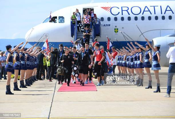 Croatian national football team members step out from their Airbus 319 airplane in Zagreb International Airport on July 16 2018 after their return...