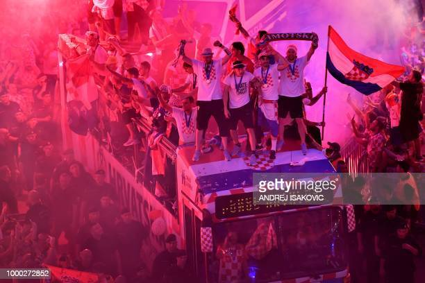 TOPSHOT Croatian national football team players ride a bus as people gather for a 'heroes' welcome' in tribute to their national team after reaching...