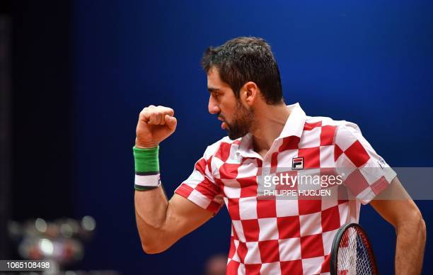 Croatian player Marin Cilic reacts during the single tennis match against French Lucas Pouille as part of the Davis Cup final between France and...