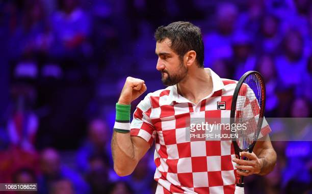 TOPSHOT Croatian player Marin Cilic reacts during the single tennis match against French Lucas Pouille as part of the Davis Cup final between France...