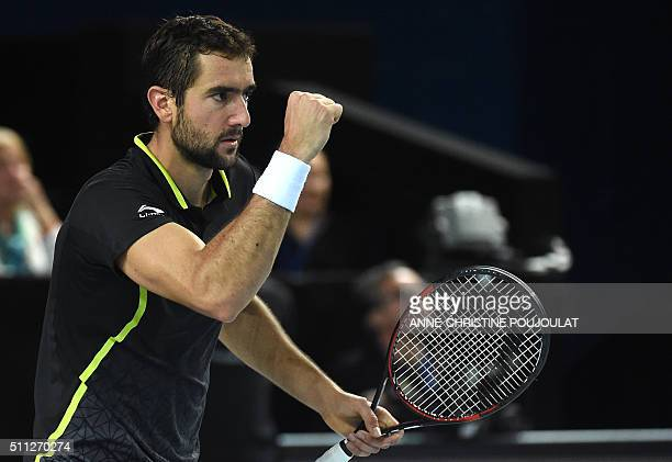 Croatian player Marin Cilic returns the ball to Russian Andrey Kuznetsov during their tennis match final quarter at the ATP Marseille Open 13...