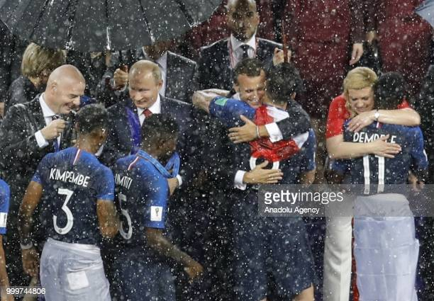 Croatian players shake hands with Russian President Vladimir Putin Croatian President Kolinda Grabar Kitarovic French President Emmanuel Macron and...