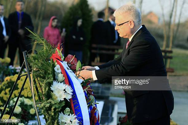 Croatian President Ivo Josipovic pays tribute to some 18 Serb civilians killed by Croatian solders in 1991 on November 4 at Paulin dvor memorial site...