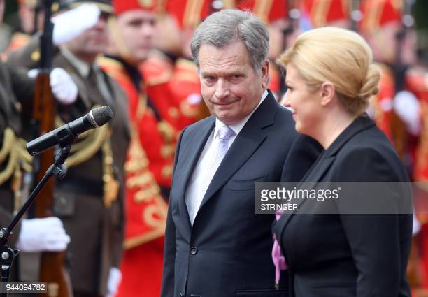 Croatian President Kolinda Grabar Kitarovic and her Finland's counterpart Sauli Niinisto attend a welcoming ceremony at the Presidential Office in...