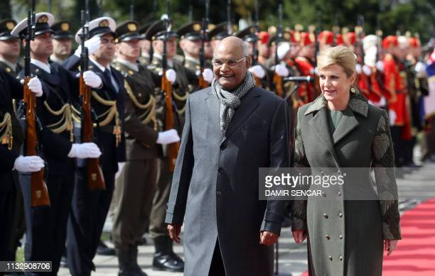 Croatian President Kolinda Grabar Kitarovic and her Indian counterpart Ram Nath Kovind inspects honour guard during a welcoming ceremony at the...