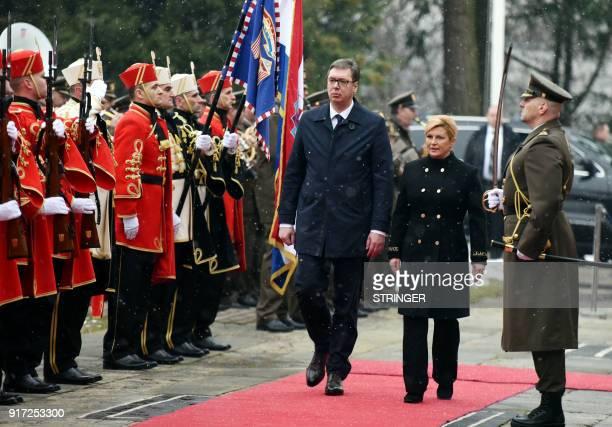 Croatian President Kolinda Grabar Kitarovic and her Serbian counterpart Aleksandar Vucic inspect the guard of honor during a welcoming ceremony at...
