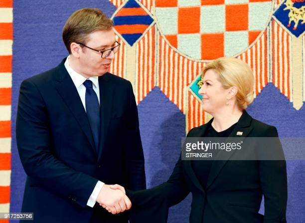 Croatian President Kolinda Grabar Kitarovic and her Serbian counterpart Aleksandar Vucic shake hands prior to their meeting at the Presidential...