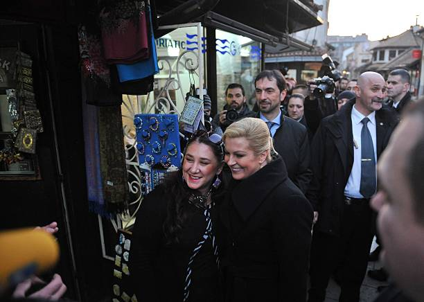 Croatian President Kolinda Grabar Kitarovic poses for a photograph during her visit to the ancient district of Sarajevo on March 3, 2015. Kitarovic...