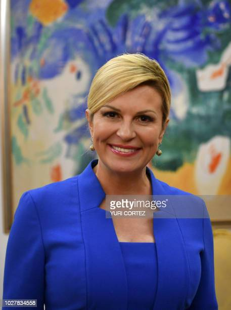 Croatian President Kolinda Grabar Kitarovic poses for pictures after a private meeting with Salvadoran AFP photographer Yuri Cortez's family at the...