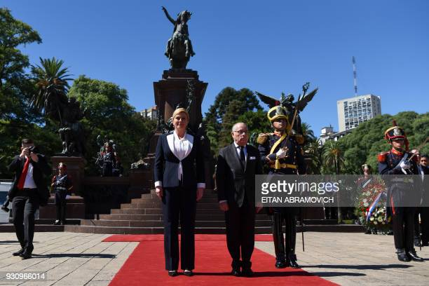 Croatian President Kolinda GrabarKitarovic and Argentine Foreign Minister Jorge Faurie take part in a wreathlaying ceremony to pay homage to...