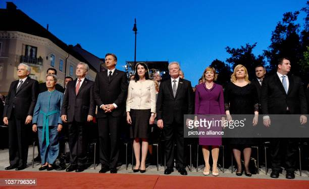 Croatian President Kolinda GrabarKitarovic and her husband Jakov Kitarovic German President Joachim Gauck and his partner Daniela Schadt Slovenian...