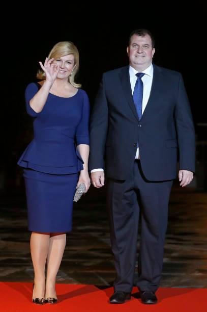 Croatian President Kolinda Grabar-Kitarovic and her husband Jakov Kitarovic arrive to attend a dinner hosted by French President Emmanuel Macron at...