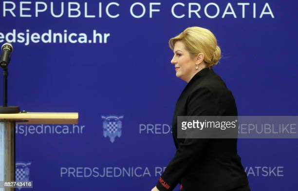 Croatian President Kolinda GrabarKitarovic arrives to address a press conference in Zagreb on November 30 a day after the suicide of former military...