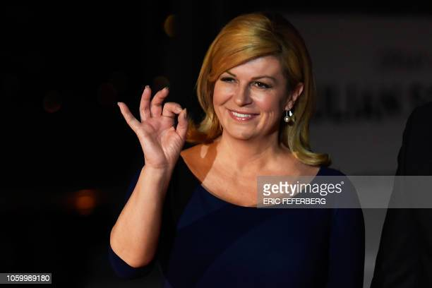 Croatian President Kolinda Grabar-Kitarovic gestures as she arrives at the Musee d'Orsay in Paris on November 10, 2018 to attend a state diner and a...