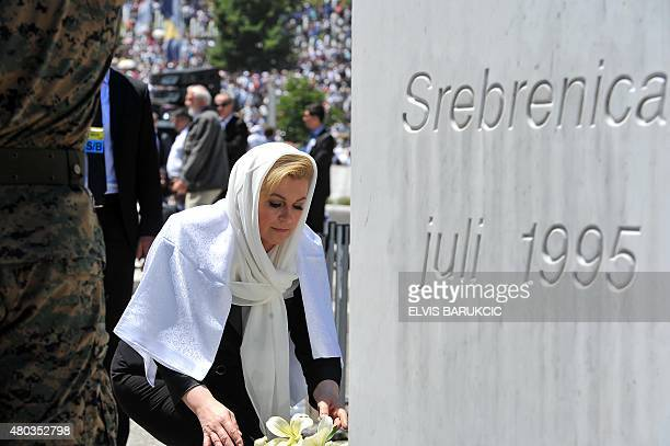 Croatian President Kolinda GrabarKitarovic lays flowers as she pays respect to victims during a burial ceremony in Potocari Memorial Cemetery on July...