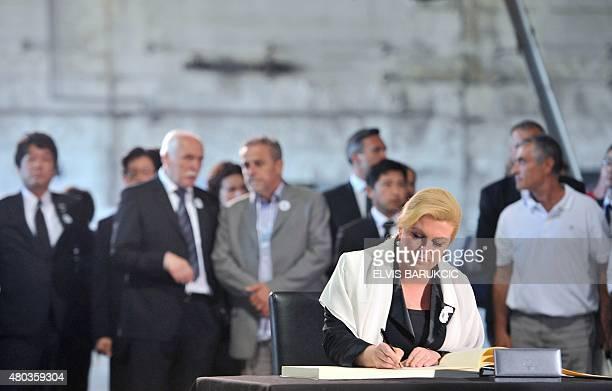 Croatian President Kolinda GrabarKitarovic signs condolence book at Potocari memorial center prior to burial ceremony in Potocari Memorial Cemetery...