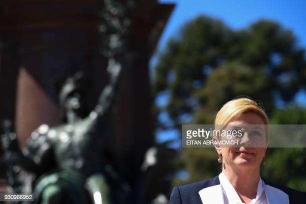 Croatian President Kolinda GrabarKitarovic takes part in a wreathlaying ceremony to pay homage to Argentine national hero General Jose de San Martin...