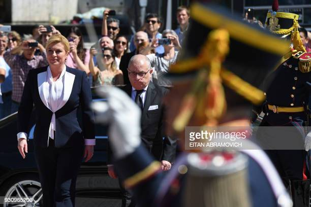 Croatian President Kolinda GrabarKitarovic walks next to Argentine Foreign Minister Jorge Faurie during a wreathlaying ceremony to pay homage to...