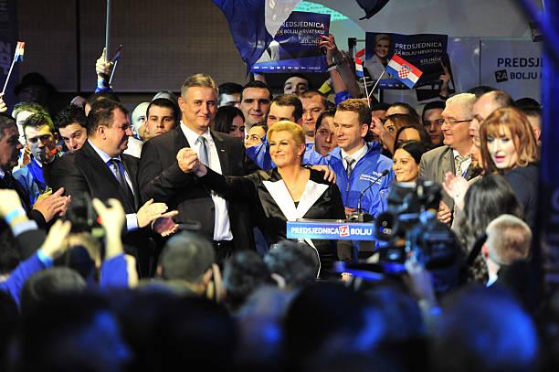 Croatian Presidential Candidate from Democratic Union Kolinda Grabar-Kitarovic and HDZ president Tomislav Karmarko celebrate after hearing the first...