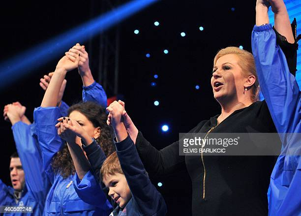 Croatian Presidential candidate Kolinda GrabarKitarovic attends a campaign rally in the southern Bosnian city of Mostar on December 15 2014 Along...