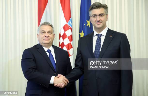 Croatian Prime minister Andrej Plenkovic shakes hands with his Hungarian counterpart Viktor Orban prior to their meeting in Zagreb on December 3 2018...