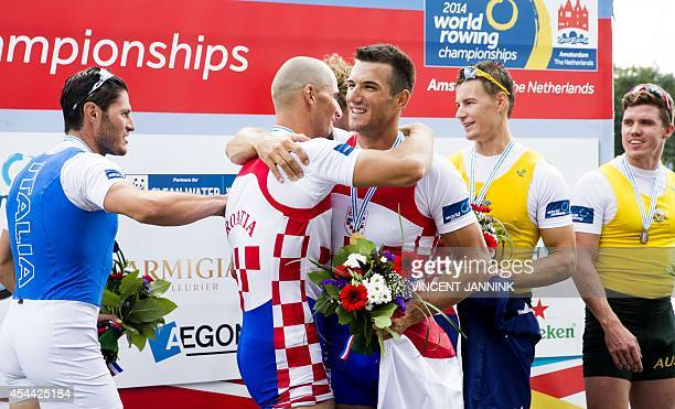 Croatian rowers Martin Sinkovic and Valent Sinkovic celebrate after winning the Men's Double Sculls Final of the World rowing championships in...