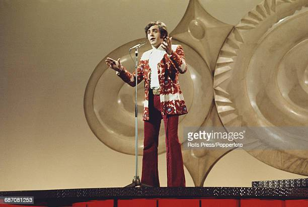 Croatian singer Kico Slabinac performs the song 'Tvoj djacak je tuzan' on stage for Yugoslavia in the 1971 Eurovision Song Contest at the Gaiety...