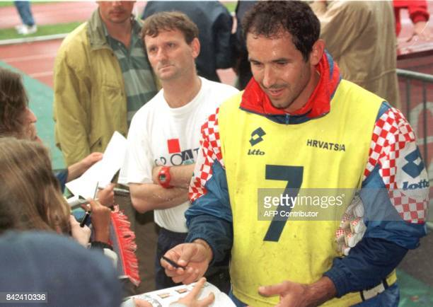 Croatian soccer goalkeeper Drazen Ladi signs autographs after a training session with his team at Jean Boulomie stadium in Vittel eastern France 02...