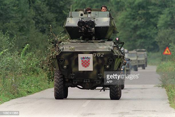 Croatian soldiers operate an armored personnel carrier or APC equiped with 3 heavy machine guns on September 26 during a battle with Yugoslav Serbian...