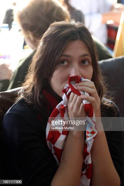 Croatian supporters look on during the FIFA World Cup Russia final against France at Dobar Tek Bar on July 15 2018 in Buenos Aires Argentina
