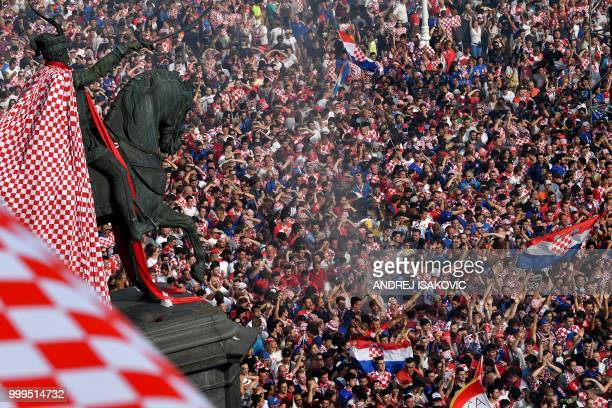 Croatian supporters celebrate the equalizer in downtown Zagreb on July 15 during the 2018 Russia World Cup final football match between Croatia and...
