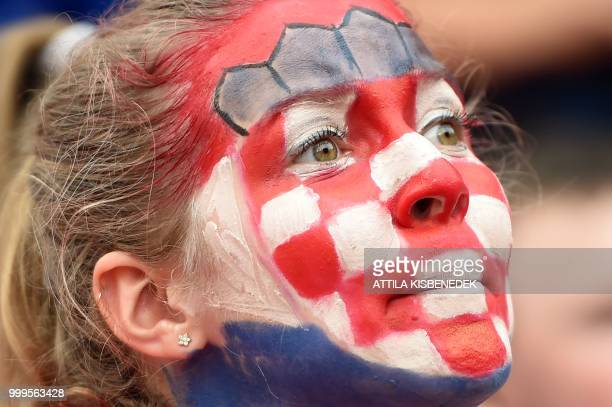 TOPSHOT Croatian supporters celebrate with their national flag in Zagreb downtown on July 15 after the final football match of the FIFA World Cup...