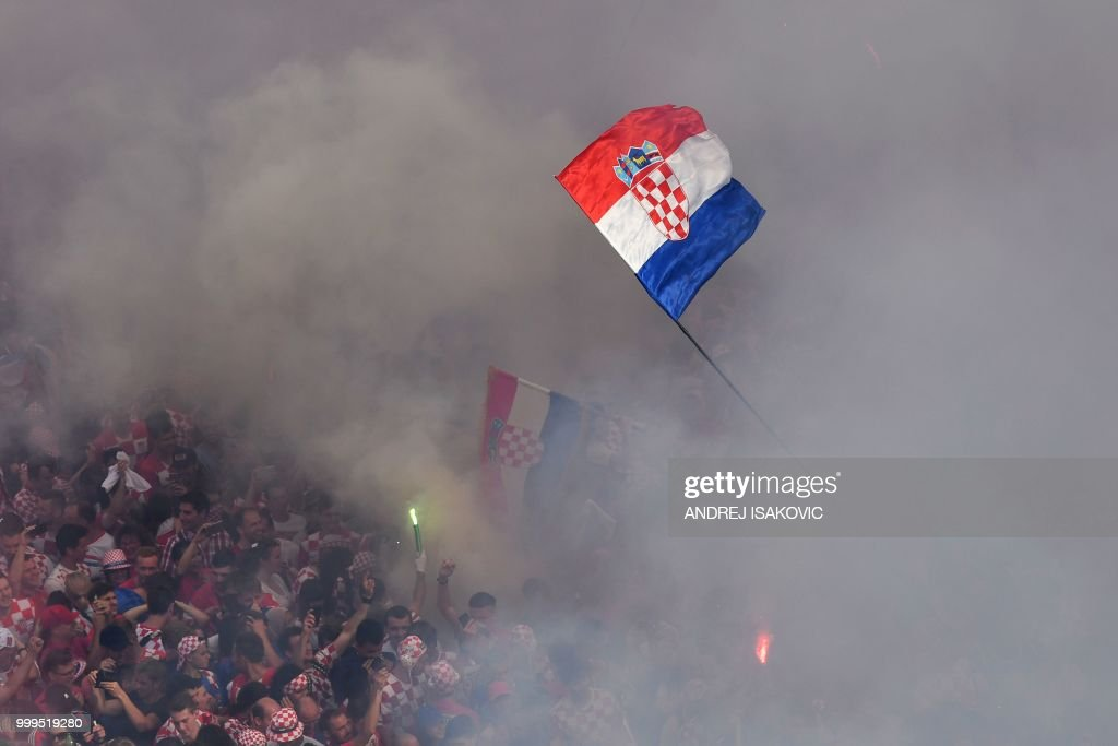 Croatian supporters cheer in downtown Zagreb on July 15, 2018, ahead of the 2018 Russia World Cup final football match between Croatia and France, the first final World Cup match ever in the history of Croatia.