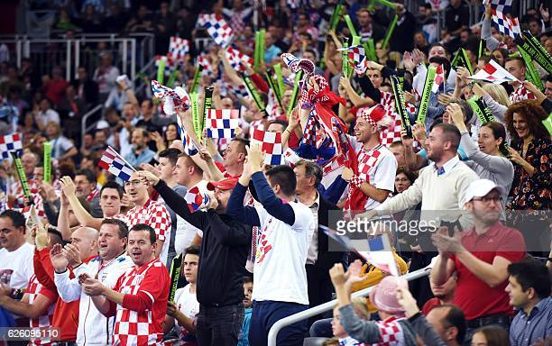 Croatian supporters cheer on Croatia's tennis player Marin Cilic during the Davis Cup World Group final singles match between Croatia and Argentina...