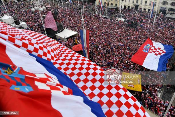 Croatian supporters hold a huge Croatian flag in downtown Zagreb on July 15 as they gather to watch the Russia 2018 World Cup final football match...