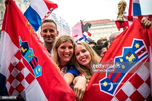 TOPSHOT Croatian supporters hold national flags in downtown Zagreb on July 15 ahead of the 2018 Russia World Cup final football match between Croatia...