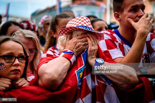 TOPSHOT Croatian supporters react after the 2018 Russia World Cup final football match between Croatia and France on July 15 2018 in Zagreb the first...
