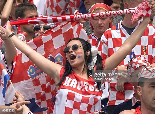 Croatian supporters wave their colors 26 June at the Parc Lescure in Bordeaux before the 1998 Soccer World Cup Group H first round match between...
