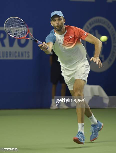 Croatian tennis player Ivo Karlovic returns the ball as he plays against South African Kevin Anderson during their men's single final match for the...