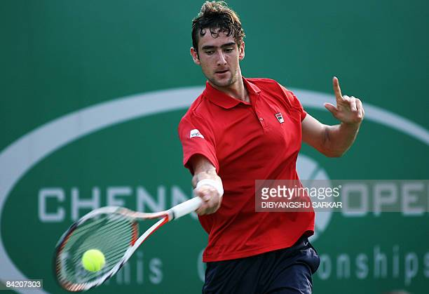 Croatian tennis player Marin Cilic plays a return shot to his Uzbek opponent Denis Istomin during their second round match at The ATP Chennai Open...