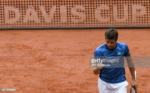 Croatian tennis player Nikola Mektic celebartes during the Davis Cup doubles tennis match against Colombia at La Santamaria Bullring in Bogota on...
