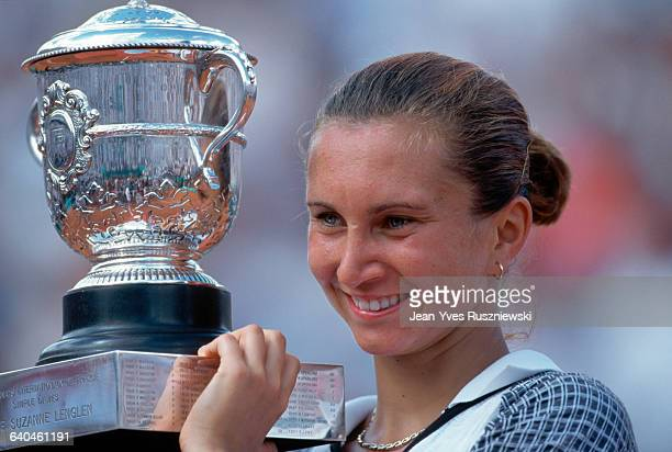 Croatian tennis star Iva Majoli holds her tennis trophy after beating Hingis | Location Auteuil France
