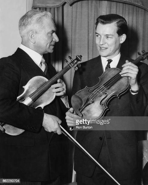 Croatian violinist Zlatko Balokovic discusses his upcoming concert at the Festival Hall in London with the conductor Alexander Gibson 8th March 1957...