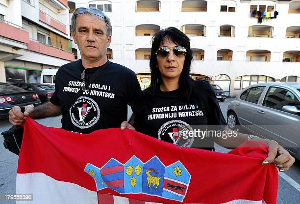 Croatian war veteran Darko Solic and his companion Drazena Celan both from the coastal town of Split join a protest on September 4 2013 in Vukovar...
