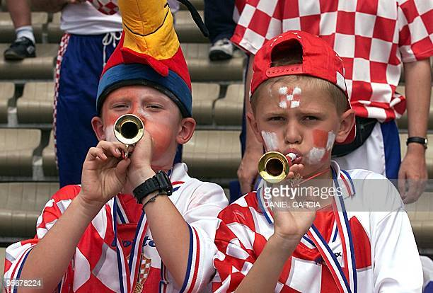 Croatian young supporters play music 26 June at the Parc Lescure in Bordeaux before the 1998 Soccer World Cup group H first round match between...