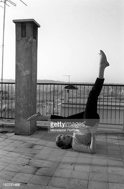 Croatian-born Italian actress Sylvia Koscina doing exercises on a terrace. 1950s