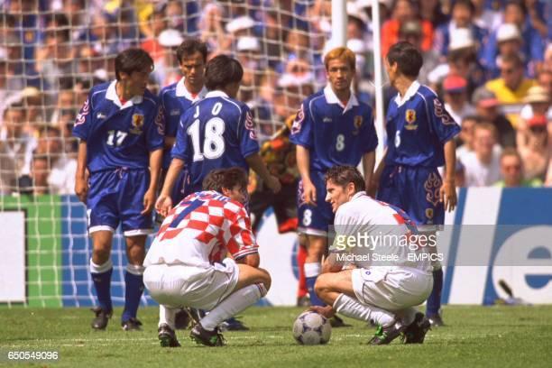 Croatia's Aljosa Asanovic and Davor Suker line up a free kick