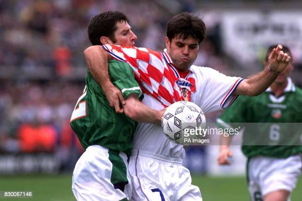 Croatia's Aljosa Asanovic shields the ball from Ireland's Denis Irwin during this afternoon's European Championship qualifier at Lansdowne Road in...