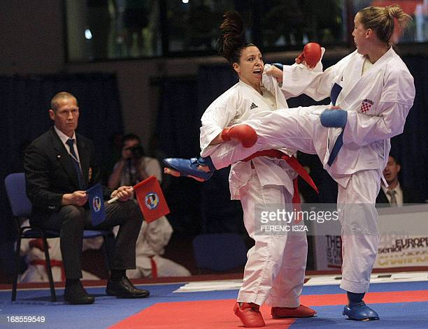 Croatia's Anamarija Celan fights against France's Alexandra Recchia to win the gold medal in the team's finals at the 48th Karate Senior European...